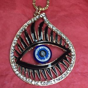 Evil eye necklace with big black lashes, gold tone